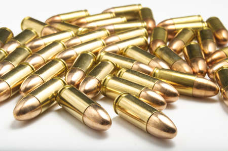 9mm bullets on white background
