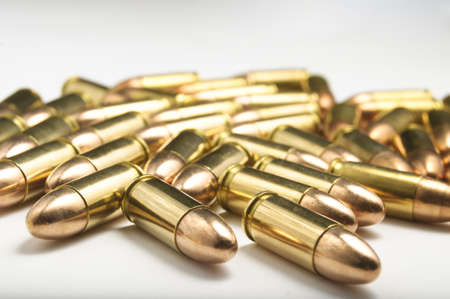 9mm bullets on white background photo
