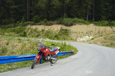 Red enduro motorcycle on the road