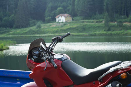 Motorcycle by the lake