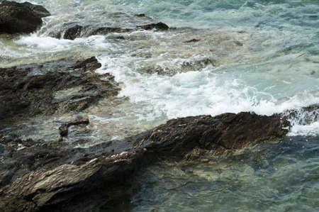 Sea waves hitting shore reef  版權商用圖片