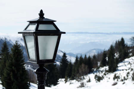 Outdoor lamp in winter landscape in mountains. Stock Photo