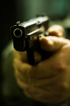 Gun pointed at camera