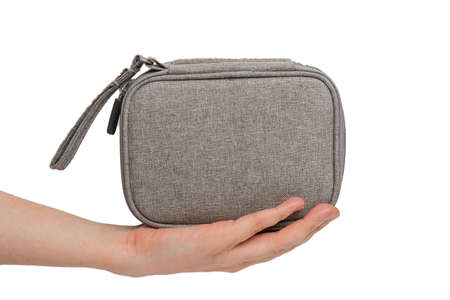 grey bag in hand on a white background close up. Imagens