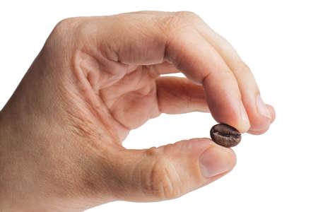 coffee beans in hand on a white background. Standard-Bild