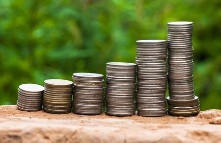 coins graph on green background  it is photographed outdoors  photo