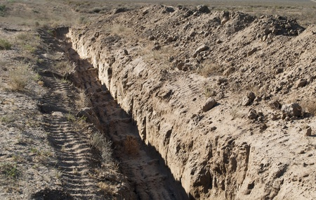 trencher: the trench dug in the earth in the desert
