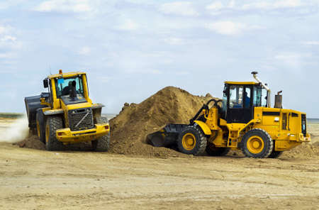 equipment:  construction of the road, digging works by means of special equipment Stock Photo