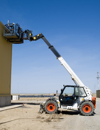 telescopic loader on work photo