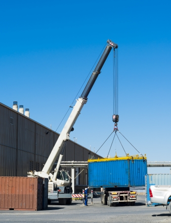 Crane works. Container loading on the truck photo