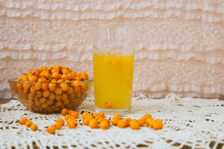 argousier: buckthorn on a handful of therapeutic knitted napkin