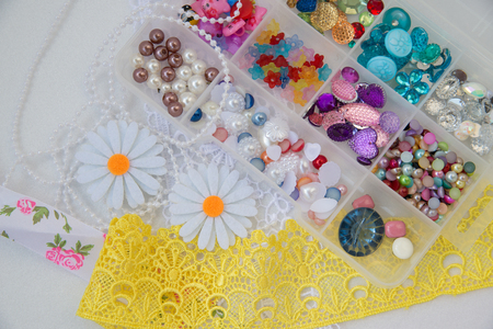 Colored rhinestones lace and beads for needlework Stock Photo