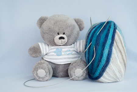 combined blue yarn for knitting with a bear