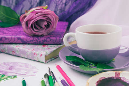 watercolor sketch of a purple rose with a Cup of tea