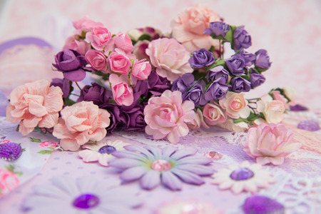 purple and pink paper flowers and rhinestones