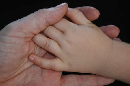Adult holding a childs hand