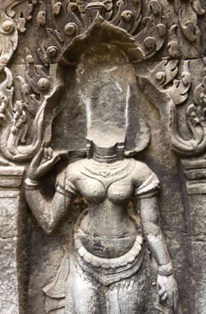 phrom: Bas-Relief at Ta Phrom temple showing a  Apsara without head which was stohlen