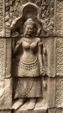 phrom: Bas-Relief at Ta Phrom temple showing a  Apsara