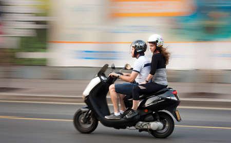 belgrade: Belgrade, Serbia - June 24, 2016: Young couple on a motorbike  in the center of Belgrade, Serbia Editorial