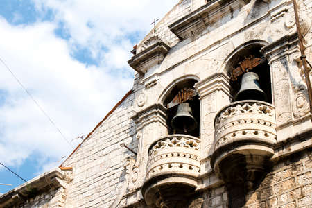 Serbian orthodox Church of the Assumption of the Virgin Mary, detail with bells,  in old town Sibenik , Croatia, low angle view Фото со стока