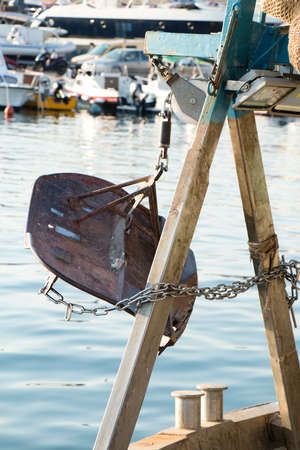Trawl doors, otter boards, on a Mediterranean fishing trawler boat, moored
