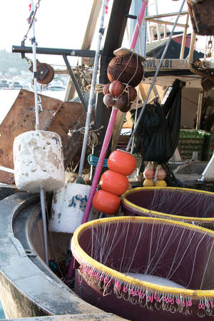 Long line fishing gear, containers with hooks and floaters, inside a boat, equipment for traditional commercial fishing technique in Adriatic sea