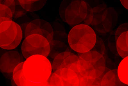 Abstract blurry red light ornament, lots of dots glowing in the night, Christmas background