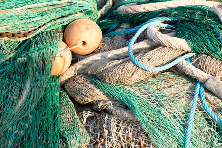 Bunch of old weathered trawl fishing net background 免版税图像