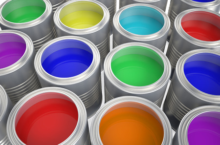 Cans with color paint isolated on  white background photo