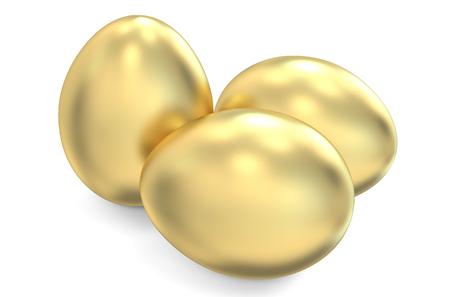 huevos de oro: huevos de oro aislados sobre fondo blanco Foto de archivo