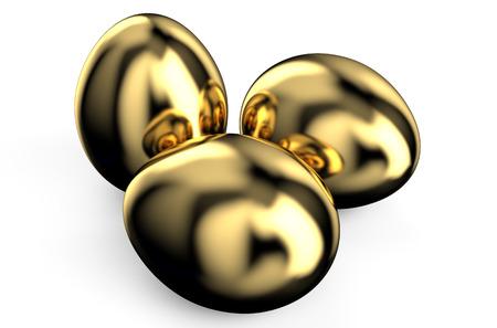 huevos de oro: tres huevos de oro aislados sobre fondo blanco