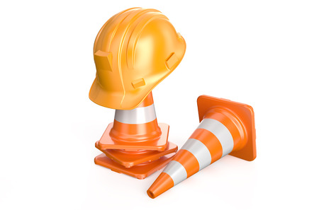 Traffic cones and hardhat  isolated on white background photo