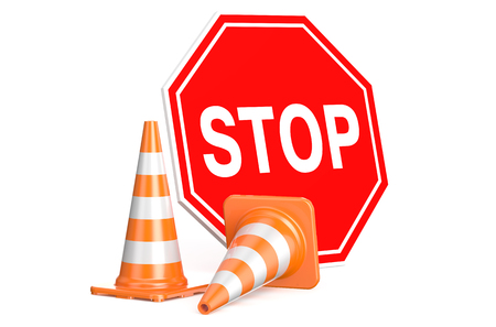Traffic cones and sign stop isolated on white background photo