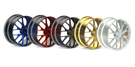 rims: row from colored car rims  isolated on white background Stock Photo