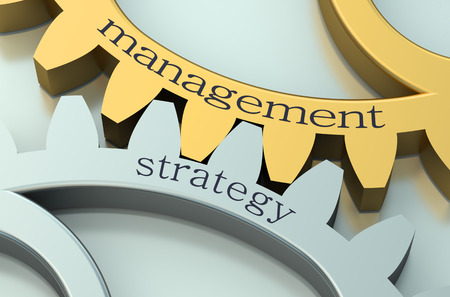 strategies: Management and Strategy concept on metallic gearwheel Stock Photo