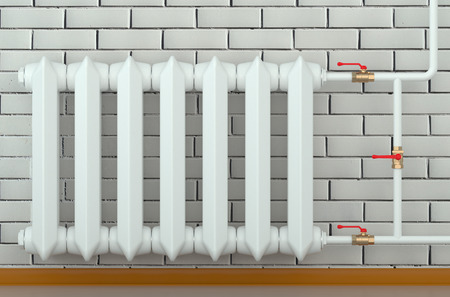 convective: cast iron radiator at home isolated on white background