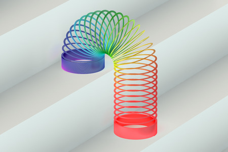 springy: Rainbow colored plastic Slinky toy