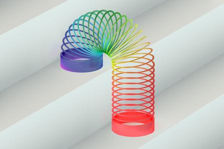 Regenboog gekleurde plastic Slinky speelgoed Stockfoto