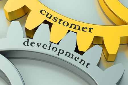 client service: Customer Development concept on the gearwheels Stock Photo