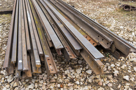 stockroom: steel rails in factory warehouse