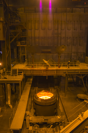 smelting plant: metallurgical ladle with steel in the workshop