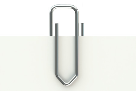 Metal paperclip and paper isolated on white background