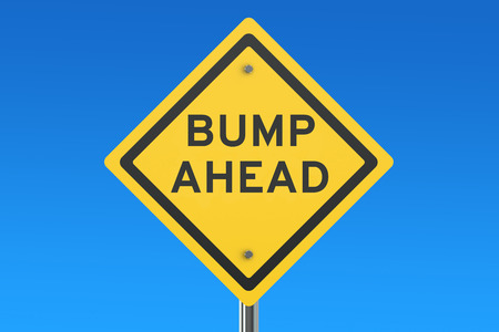 caution: Bump Ahead road sign isolated on blue sky