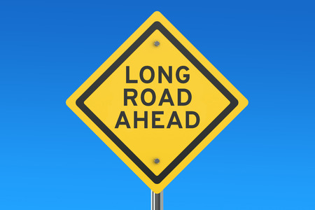 road ahead: long road ahead road sign isolated on blue sky Stock Photo