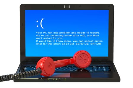laptop screen: Laptop with blue error screen and handset Stock Photo