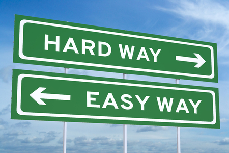 easy way: Hard way or Easy way concept on road sign Stock Photo