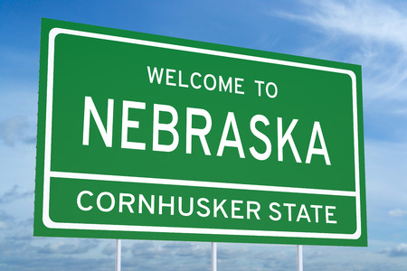 accomplish: Welcome to Nebraska state concept on road sign Stock Photo