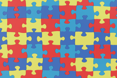 Puzzle Pieces in Autism Awareness Colors Background, 3D rendering Standard-Bild