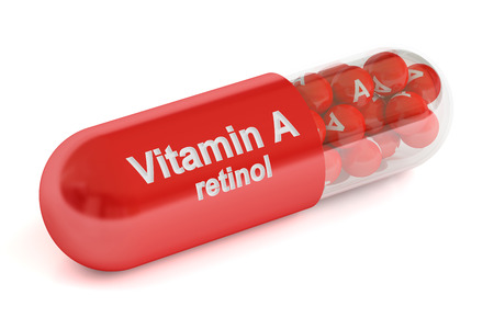 vitamin a: Vitamin A capsule, 3D rendering isolated on white background Stock Photo