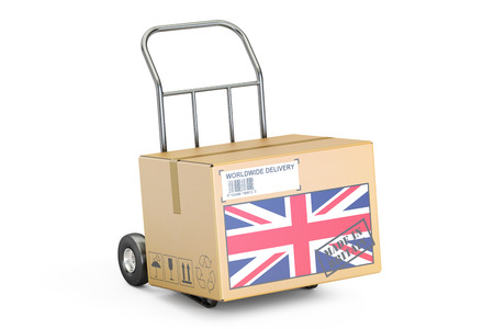 corrugated box: Made in UK concept. Cardboard Box on Hand Truck, 3D rendering isolated on white background Stock Photo
